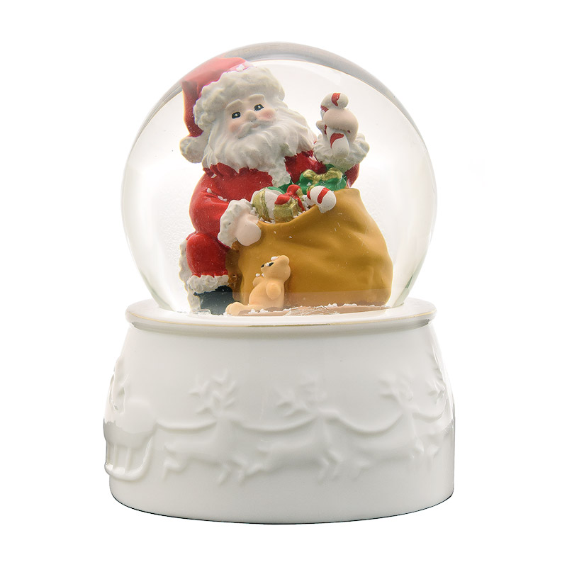 White porcelain bottom Snowglobe featuring Santa opening presents